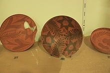 Nabataean pottery is characterized by its thin walls and floral motifs. The exclusive use of floral patterns links back to Nabataean aniconism in their religious practices. The designs on the wares are generally painted on or pressed into the surface with stamps and rouletting wheels. To put a finish on the pieces, the makers burnished them or used a sintering process.