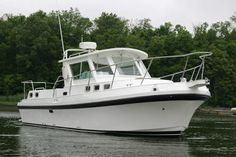 Tha Albin 30 aft cabin Family Cruiser is small for the job, but it starts our list of potential live-aboards.