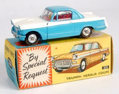 Lot 1744 - Corgi Toys, 231 Triumph Herald Coupe, blue and white body with red interior, shaped spun hubs, in