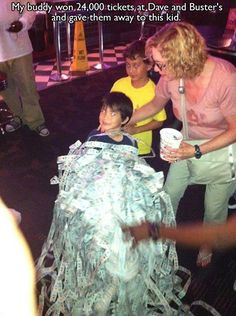man wins 24,000 tickets at Dave & Busters and gave them all to this little boy! Lucky kid!