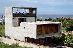 Hausbau am Meer Modern mit Sichtbeton Neubau