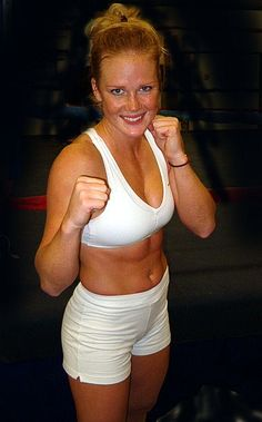 IBA Female Welterweight Champ,WBF Female Welterweight Champ and the WBF Female Light Welterweight Champ, Holly Holm