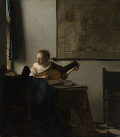 WOMAN WITH A LUTE by Johannes Vermeer