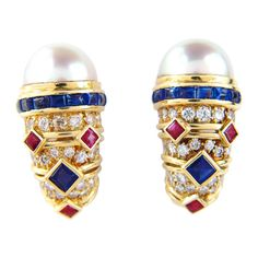 Beautiful BULGARI Pearl, Sapphire, Ruby, Diamond and Yellow Gold Earrings. The total earring's weight is 18.3 grams. The total weight of Diamond: 2.5cts, G color and VVS-2 clarityThe measurements of Pearl: 10x10mm, each size of earring. The weight of Sapphire: 1ctsThe weight of Ruby:0.6cts. The size of the earring: 23x13mm. Estate