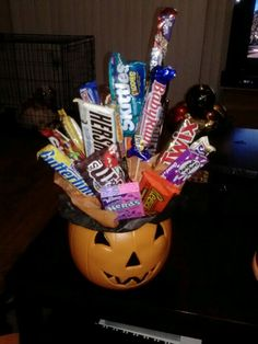 Candy bouquet! #DIY #candycenterpiece  All you need are skewers,  hot glue gun to stick skewers to candy, tissue paper and Styrofoam to fit according to pot/bowl.