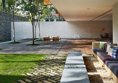 • Materials merging, paving, grass, deck, cantilever awning + white and stone wall • Casa Panama by Studio MK27 | Yellowtrace