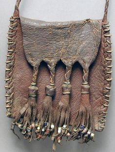 x x x ~ 'Africa | Leather and glass bead purse bag from the Wodaabe of Mali and Niger.  ca. 1970s. | Wodaabe or Bororo are a small subgroup of the Fulani ethnic group.'