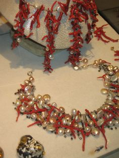Jewelry created from Coral and Pearls in the windows of a Paris Boutique.