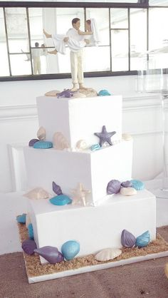 Beach wedding cake with our Just Married Beach Couple Cake Topper (http://www.weddingfavorsunlimited.com/beach_wedding_figurine_-caucasian.html)