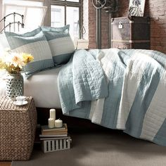 Refresh your master suite or guest room with this lovely cotton quilt set, showcasing a stripe motif for eye-catching appeal.   Pro...