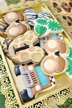 Take a look at the fun mix of Mickey Mouse safari cookies at this Mickey Mouse Safari birthday party. See more party ideas and share yours at CatchMyParty.com Mickey Mouse Cookies, Mickey Mouse Parties, Mickey Party, Safari Birthday Party, Jungle Party, Jungle Safari, Baby Shower Cakes, Birthdays, Party Ideas