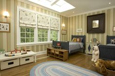 This delightful little boys' room is flooded with natural light from the skylights.