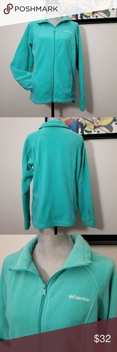 """Columbia full zip fleece Large Large fleece in blue-green. Full zip up. Zipper pull has peeling paint. Embroidered Columbia in white on left chest. Zip up front pockets.  Excellent used condition. Flat lay measurements: Approximately 22"""" bust, 16"""" from underarm to hem Columbia Jackets & Coats"""