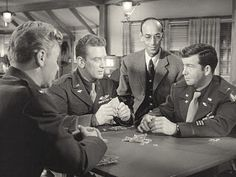 James R. Martin, Kenneth Tobey, Douglas Spenser, and Robert Nichols