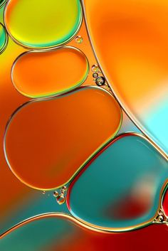 Oil and Water Abstract in Orange by Sharon Johnstone
