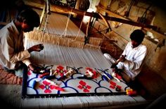 Nemaram and his son working on the loom in Jodhpur, Rajasthan