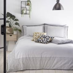 Go dotty for this stylish spotty duvet cover set in a timeless yet contemporary monochrome design. Taking inspiration from the Danish Hygge lifestyle trend embracing a feeling of cosy contentment from enjoying the simple things in life, this pure brilliant white bedding is crafted in soft 100% cotton and adorned with a sprinkling of black polka dots and trimmed with chic black piping. Snuggle under these covers with a good book and enjoy!