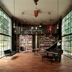 Walls of windows & built-in bookcases. Small loft and lights on pulleys are neat too.