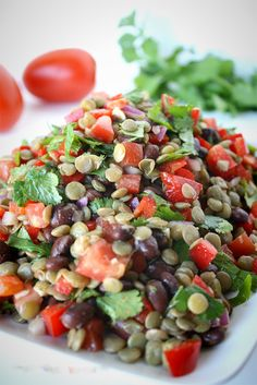 Combine lentils, black beans, bell peppers, and tomatoes to make this salad.