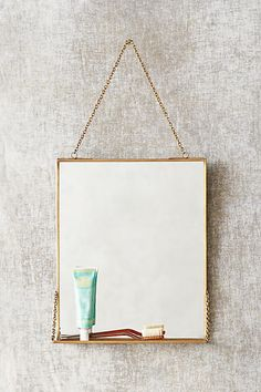 Brass Mirror Shelf