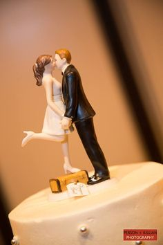 "What a cute shot! Great for a couple who loves travel - it's our ""A Kiss and We're Off"" topper! http://www.weddingstar.com/product/a-kiss-and-we%27re-off-figurine"