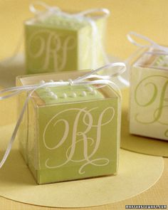 DIY Weddings | Martha Stewart Weddings  Go to External Site  »  Elegant Cookie Cubes  For a sophisticated favor, stack cookies in a plastic box lined with your monogram on all sides. To line the box, scan calligraphed initials and print onto card stock -- back with glassine using double-sided tape. Score and fold to fit in box