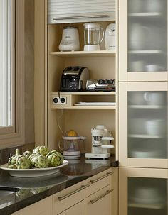 extra-deep corners that often go to waste. Put this area to work storing small appliances. Install a door that slides down to conceal the contents.