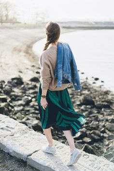 Green pleated midi skirt and sneakers / Jess Ann Kirby