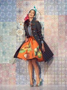 Stella Jean primavera estate 2014: cultura creola e stile italiano in questi capolavori della moda Stella Jean gonna a ruota arancione e frutti esotici