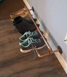 This copper pipe shoe rack makes it easy to organize and keep shoes neat and tidy. Easily vacuum or mop under your shoes. Installs in studs on center) or use wall anchors to secure this stylish rack. (Hardware not included) Picture shows the 32 inch mo Best Shoe Rack, Diy Shoe Rack, Shoe Racks, Wall Shoe Rack, Wall Shoe Storage, Wall Mounted Shoe Rack, Shoe Wall, Shoe Rack Closet, Laundry Storage