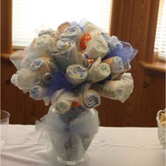 Baby shower diaper bouquet Diaper Shower, Baby Shower Diapers, Baby Boy Shower, Baby Showers, Diaper Bouquet, Nappy Cakes, Baby Shower Centerpieces, Baby Crafts, A Blessing