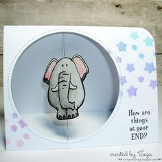 """Card inspiration: """"The stamped elephant is suspend by thread in the center of the card and spins around, made even cuter by the fact it's a double sided stamp and when it spins around you see his back side! Find directions for making this fun card over at Skipping Stones Designs blog."""""""