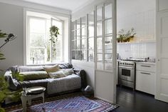 Beautiful and Practical: Windows Indoors | Apartment Therapy pretty way to separate kitchen in a small space