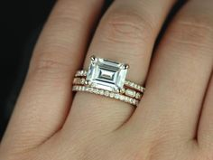 this seems to be only reproduction of Kate Beckinsale's horizontal east west diamond engagement & wedding rings. Like so many fabulous freash mountings...it's moisennite? Why aren't any diamond vendors doing the stuff the esty sellers are???