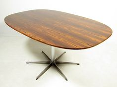 """A beautiful 1970s rosewood """"Superellipse"""" dining table by Piet Hein & Arne Jacobsen for Fritz Hansen. In excellent condition, the rosewood grain is rich and unfaded. At 150cm in length, this table comfortably seats six people. It would go very well with our Arne Jacobsen """"Seagull"""" chairs, or rosewood Kai Kristiansen chairs. This visually stunning table will withstand all the rigours of family dining."""