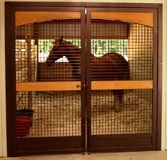 A double-door horse stall for extra wide access. Lucas Equine.
