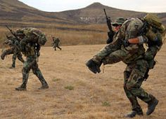 """house-of-gnar: """"CAMP PENDLETON, Calif. SEAL Qualification Training students from BUD/S Class 268 perform buddy carries between stations during a shooting test at Camp. Navy Seal Workout, Navy Seal Training, We Are The Mighty, Ranger School, Camp Pendleton, Us Navy Seals, Six Month, Military Men, Special Forces"""