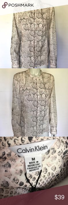 {calvin klein} dress shirt with animal print Snake skin pattern on this button down shirt. Light peach, cream, and black colored print. Comes with extra buttons. Brand new with tags! Stylish top for professional work settings. Calvin Klein Tops Button Down Shirts