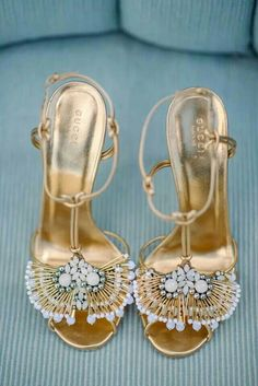Golden sandals by Gucci
