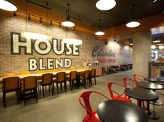 For this Starbucks in Istanbul's Besiktas area, we used typography as the primary inspiration, painting lettering from our coffee stamps across the walls. The corrugated glass pendant lights were made locally. starbuck