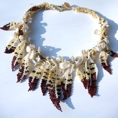 A Well Feathered Nest - Hawk Feathers - Made to Order -  Beadwoven Necklace. #beadwork, via Etsy.