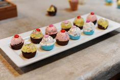 Cake ball cupcakes--they're entirely edible, just squirt melted chocolate into cupcake molds and put cake ball in it.  When it dries, decorate the top and you have an adorable mini cupcake!