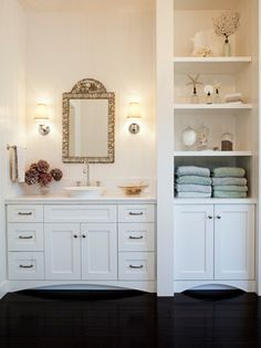 Margot Hartford Photography chic white bathroom design with white overmount vessel sink, white bathroom cabinet vanity, Restoration Hardware Lugarno Single Sconces, mosaic tiles mirror, built-ins and glossy ebony wood floors.