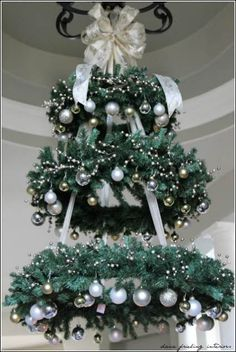 Hanging Christmas Tree - WREATH CHANDELIER ~ This would be so pretty in the entryway! this would make a very pretty outdoor tree for our porch Christmas Decor Diy Cheap, Hanging Christmas Tree, Noel Christmas, Winter Christmas, Christmas Wreaths, Holiday Decor, Hanging Christmas Decorations, Tree Decorations, Christmas Chandelier Decor