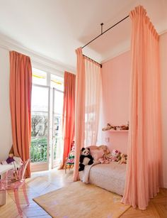 Sophisticated girls room.  Coral , industrial canopy, and romantic draperies.