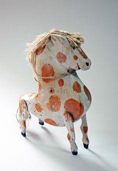Wood horse by artist Wojciech Kolacz via Grain Edit