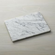 A generous rectangle of cool white marble with grey veining unique to each piece makes a sophisticated presentation of cheese, charcuterie, breads and crackers. Acidic condiments and garnishes should be placed in a ramekin or other small container to avoid discoloration of the natural marble. Coordinates with all of our French Kitchen marble items.