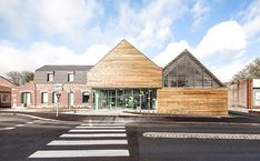 bplusb architectures adds gable-roof to dainville library - designboom B Architecture, Asphalt Roof Shingles, Fibreglass Roof, Gable Roof, Public, Small Buildings, Roofing Contractors, Flat Roof, Exterior