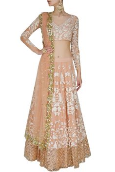 This set features a peach lehenga in net base appliqued with cream thread floral embroidery all over the front and back and criss cross sequins border around the hem. It has a can-can underlayer. Indian Bridal Lehenga, Indian Gowns, Pakistani Bridal, Indian Attire, Indian Outfits, Indian Wear, Indian Clothes, Ethnic Outfits, Desi Clothes