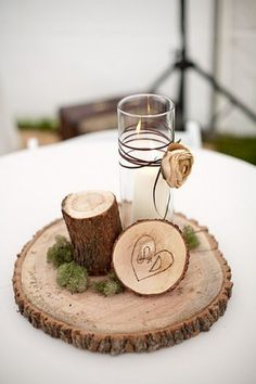 Wedding Centerpieces  Put the piece of wood inside a jar with a floating candle or flower